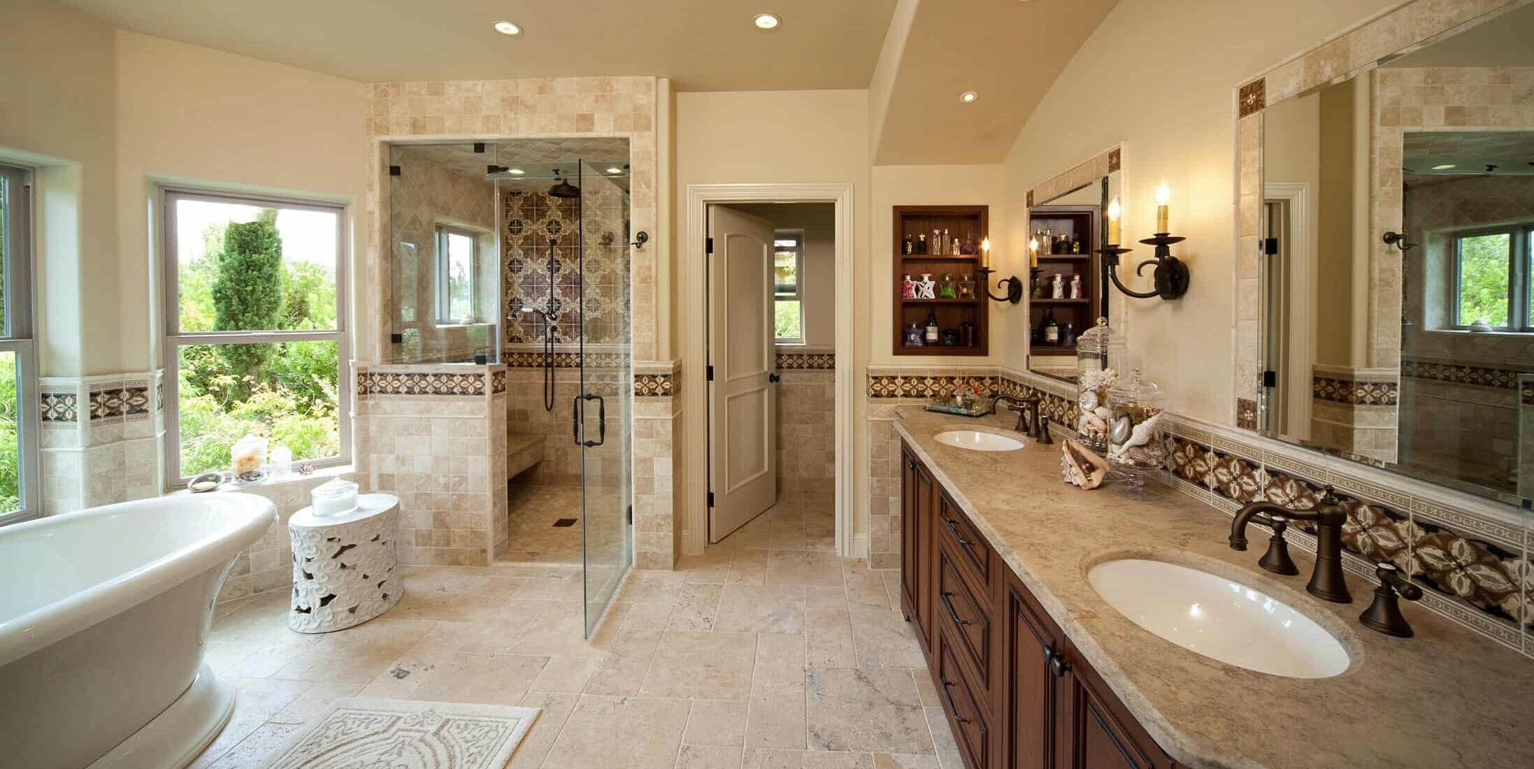 custom master bathroom with free standing bathtub walk-in shower and extensive tile work